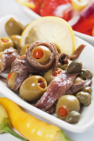 anchovy fish: Anchovy salad with olives and caper, classic italian food