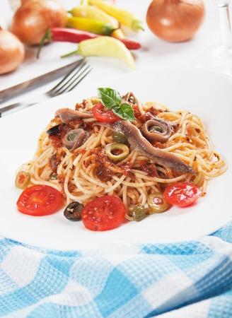 puttanesca: Spahgetti a la puttanesca with anchovy, caper, tomato and olives