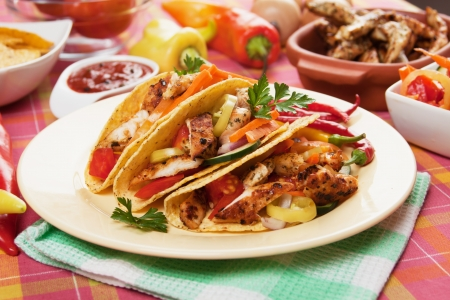 tacos: Chicken and vegetable salad served in taco shells Stock Photo