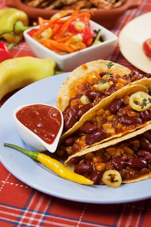 Chili con carne burritos in corn taco shells photo