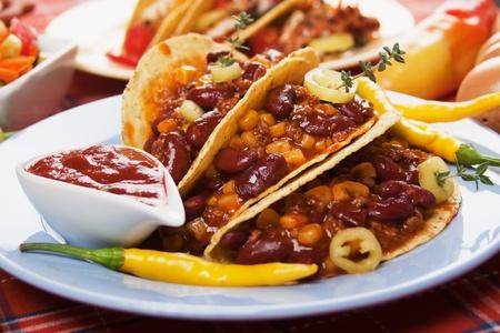 Chili con carne burritos in corn taco shells Stock Photo