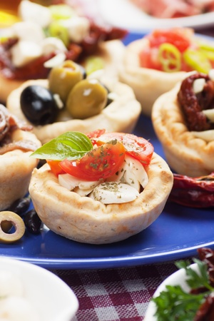 Mediterranean appetizer food, spanish tapas or antipasto snack photo