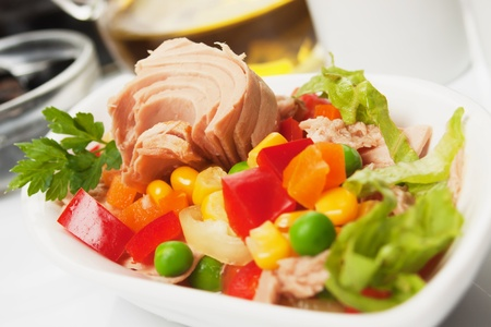 Tuna salad with corn, pepper, green peas and carrot