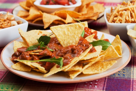 Nachos corn chips with fresh homemade chili sauce photo