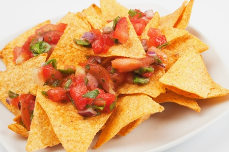 chips and salsa: Nachos corn chips with fresh homemade salsa Stock Photo