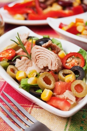 Tuna salad with olives, tomato, corn and lettuce Stock Photo - 11327364
