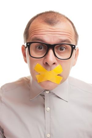 Adult Geschäftsmann mit versiegelte Mund auf weißem Hintergrund Lizenzfreie Bilder