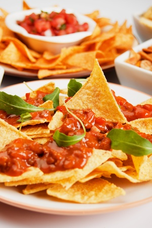 finger food: Nachos corn chips with fresh homemade chili sauce
