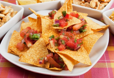 Nachos corn chips with fresh homemade salsa Imagens