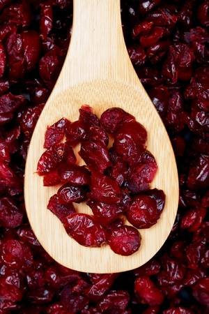 cranberry fruit: Dried cranberry fruit, food ingredient in wooden spoon Stock Photo