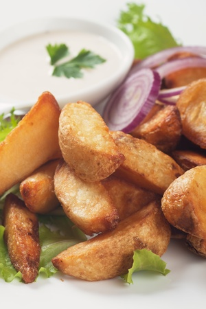 wedge: Fried potato wedges with white sauce and lettuce Stock Photo
