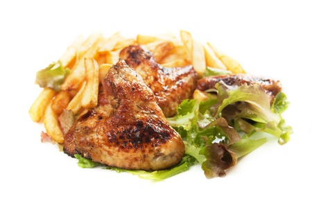 Grilled chicken wings served with lettuce and french fries photo