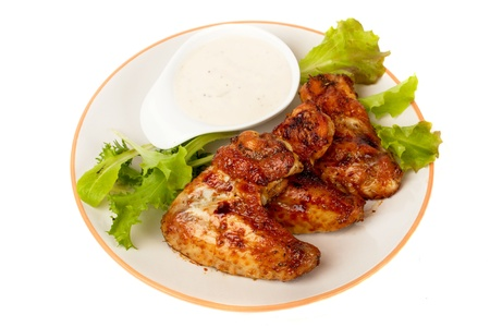 Grilled chicken wings with lettuce and white sauce photo