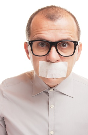 taped: Man with taped mouth isolated on white background