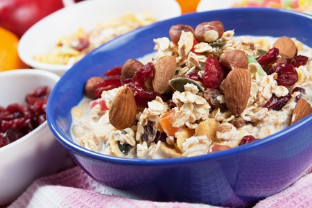 bowl of cereal: Cereal muesli breakfast wtih dried fruit and nuts Stock Photo