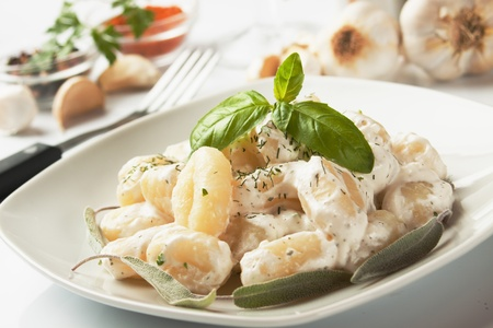 Gnocchi di patata, italian potato noodle with cheese sauce and basil