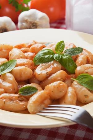 di: Gnocchi di patata, italian potato noodle with tomato sauce