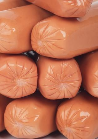 Raw hot dog sausage stack, selective focus photo
