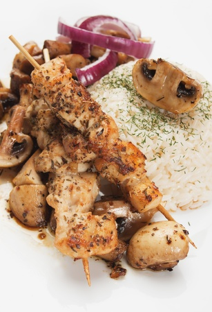 chicken kebab: Grilled chicken skewer with rice and mushrooms