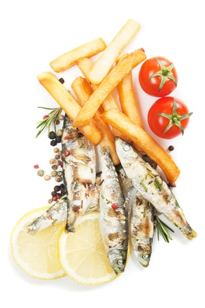 Grilled sardine fish with french fries isolated on white Stock Photo - 13513994