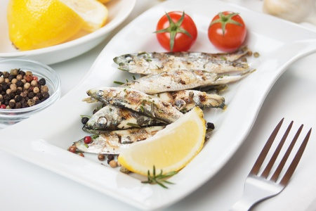 Grilled sardine fish with lemon, herbs and cherry tomato Stock Photo - 13513970