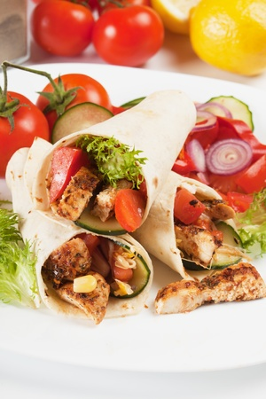 chicken meat: Grilled chicken meat and vegetable salad in tortilla wrap sandwich Stock Photo