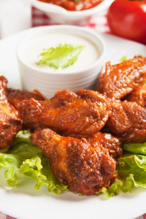 chicken wings: Buffalo style grilled chicken wings with cheese sauce