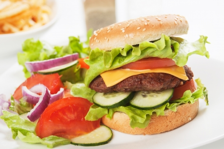 healthier: Classic hamburger served with vegetable salad, healthier fast food concept