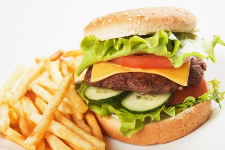 Classic hamburger with tomato, lettuce and french fries photo