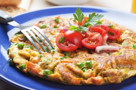an omelette: Frittata omelete with vegetables, rich and healthy meal