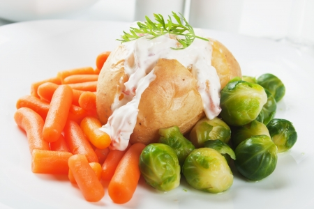 jacket potato: Jacket potato with cream sauce, baby carrot and brussels sprout