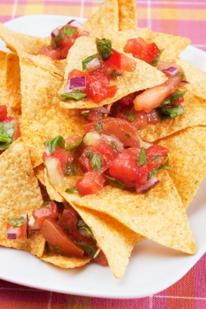 corn chip: Mexican nachos corn chips with homemade salsa