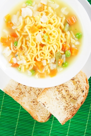 asian noodle: Asian noodle soup served with toasted bread