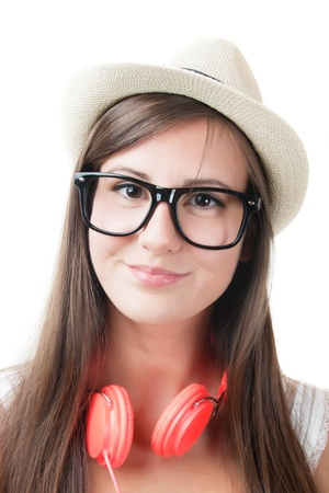 nerd girl: Young girl with headphones and hat isolated on white background