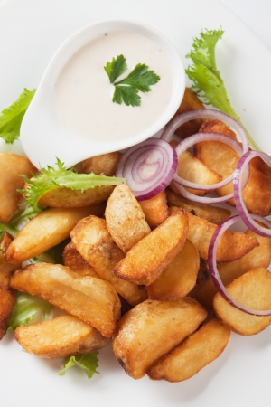 wedge: Fried potato wedges with lettuce and creamy sauce