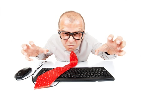Angry business man with computer keyboard and mouse, isolated on white background photo