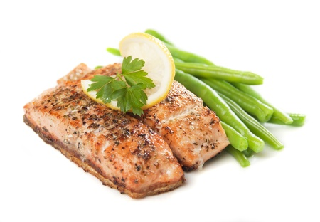 spiced: Grilled salmon steak and vegetables isolated on white background