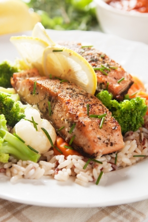 fried rice: Grilled salmon steak with cookked rice, herbs and vegetables Stock Photo