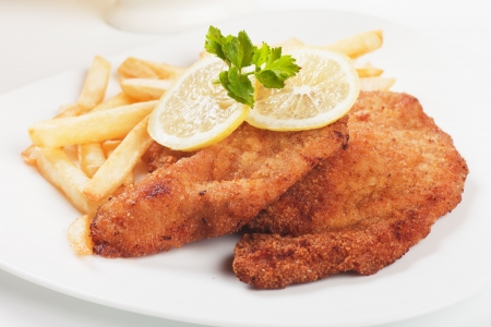 Vienner schnitzel, breaded steak with french fries and lemon