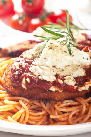 cutlets: Chicken parmesan, breaded chicken steak with tomato sauce and spaghetti pasta Stock Photo