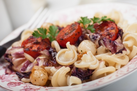 radicchio: Classic vegetarian pasta with cherry tomato and radicchio Stock Photo
