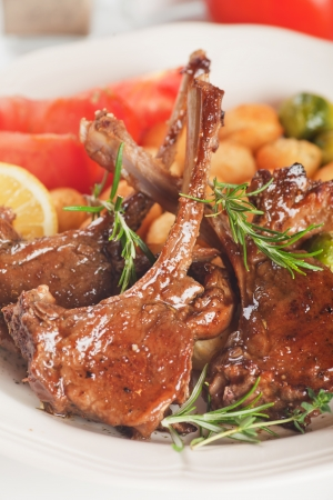 lamb meat: Roasted lamb chops with vegetables and rosemary