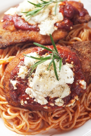 Chicken parmesan, breaded chicken steak with tomato sauce and spaghetti pasta Imagens