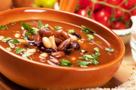 beans soup: Thick kidney bean soup in rustic bowl, selective focus image