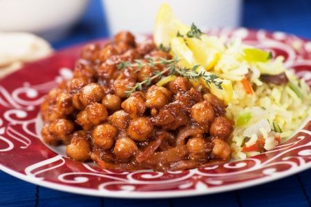 Chana masala, chickpeas with cooked rice, classic indian meal