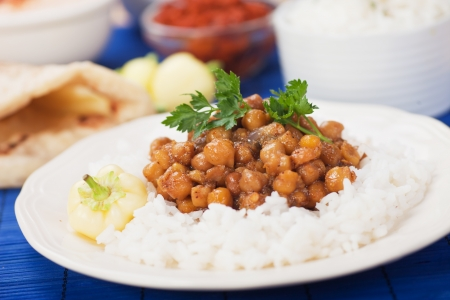 indian meal: Chana masala, chickpeas with cooked rice, classic indian meal