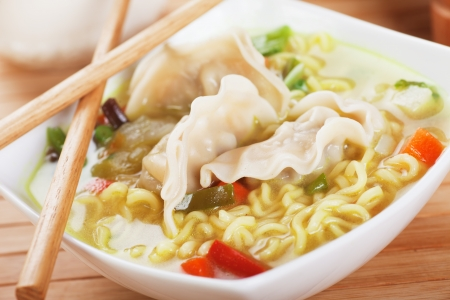 chinese noodle: Chinese dumpling and noodle vegetable soup with chopsticks