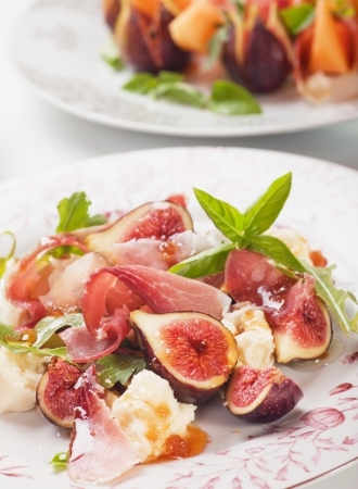 Prosciutto di Parma salad with figs and mozzarella cheese photo