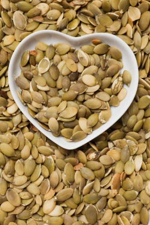 healthy snack: Pumpkin seed, healthy snack in heart shaped tray