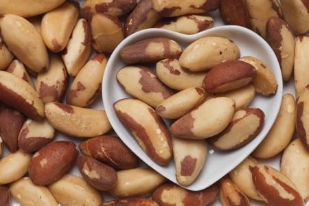 ingrediant: Brazil nut, healthy food ingredient in heart shaped tray